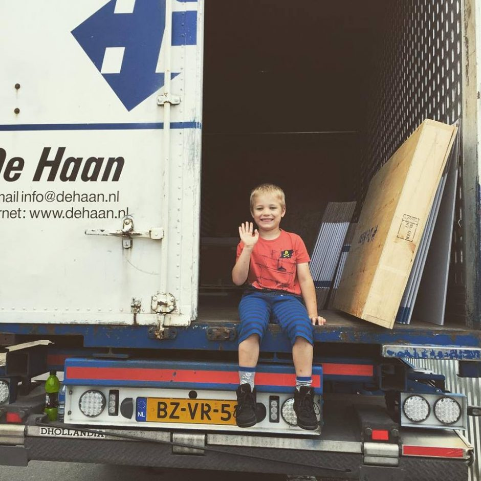 Child waving from back of lorry