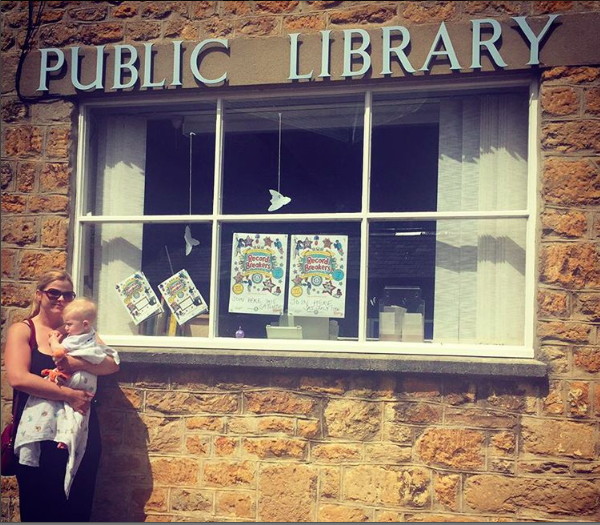 Holly Seddon and baby outside a library